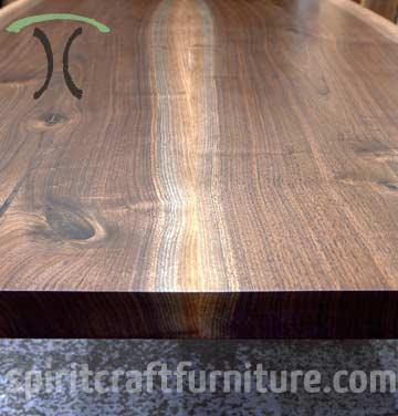 Solid Walnut live edge slab dining table with stainless legs for Massechusetts client by Spiritcraft Interior Design Furniture in East Dundee, Illinois