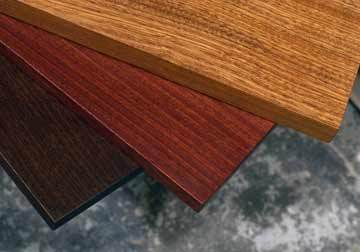 Custom made solid wood table tops for restaurant, office, library and residential clients in beautiful, dense and durable Sapele hardwood.