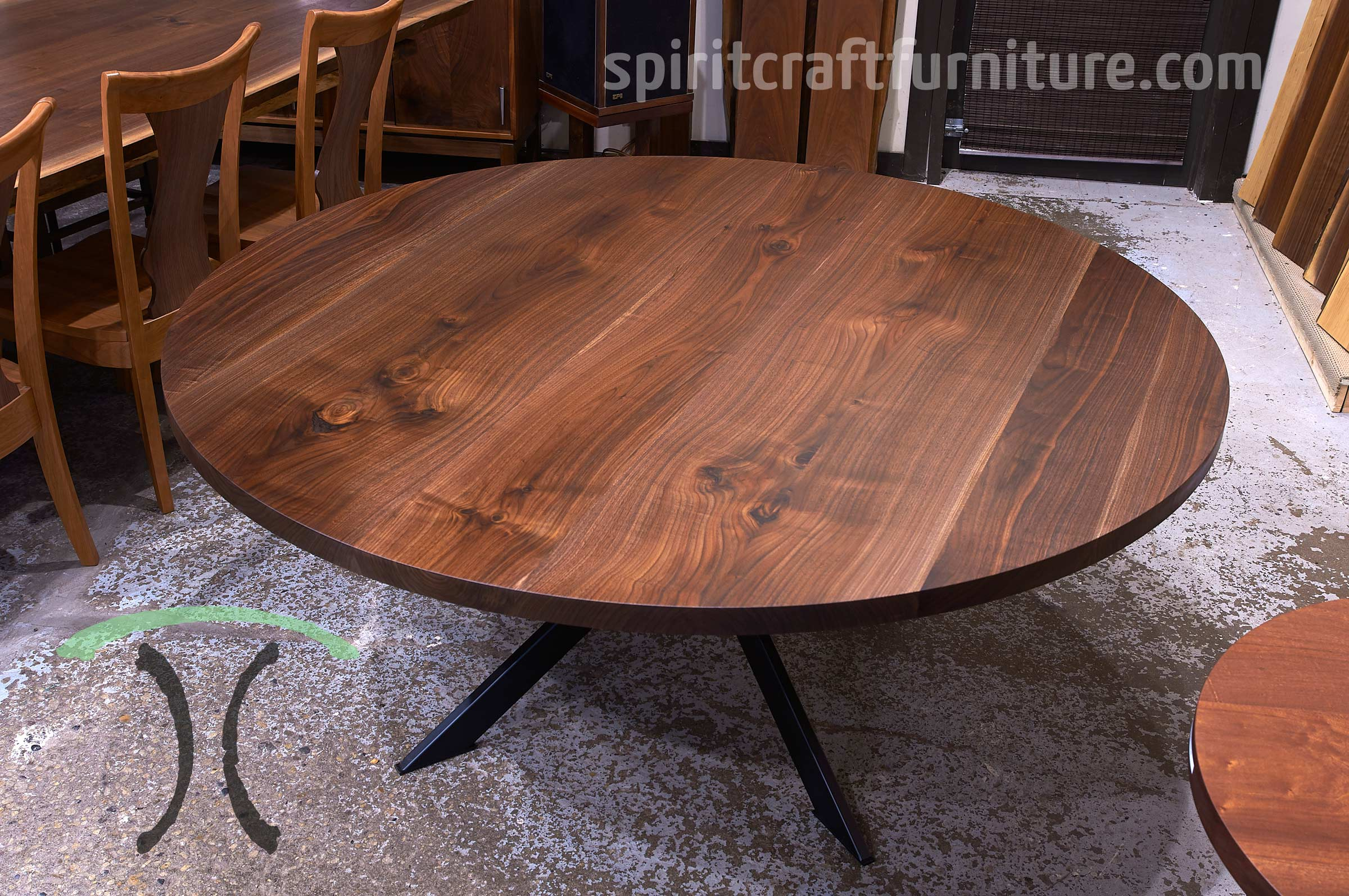 Custom made solid wood round Black Walnut table top on welded steel table base handcrafted for Highland Park interior designer by spiritcraft furniture, dundee, il.