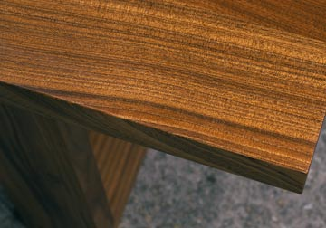 Custom made solid hardwood table top for restaurant in Sapele on trapezoid legs