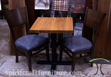 Solid wood restaurant table top on welded steel table base with RH Yoder Amish made chairs